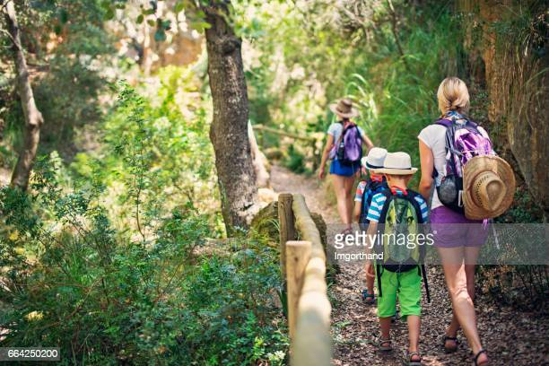 family hiking in majorca mountains - majorca stock pictures, royalty-free photos & images