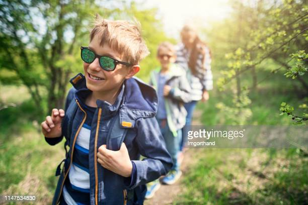 family hiking in spring forest - woodland stock pictures, royalty-free photos & images