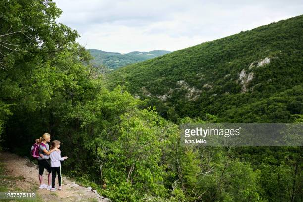family hiking in the canyons - ivanjekic stock pictures, royalty-free photos & images