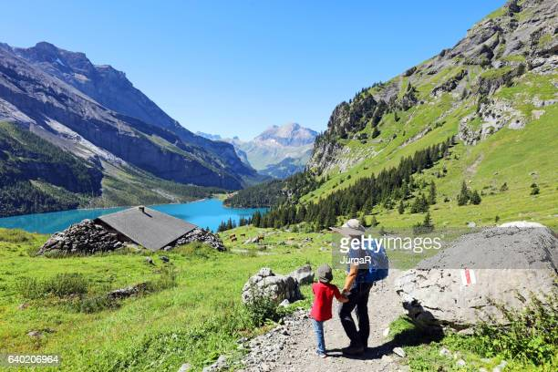family hiking in the swiss mountains - shack stock pictures, royalty-free photos & images