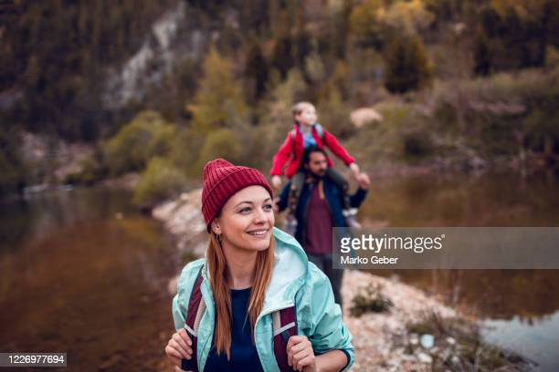 family hiking next to a lake - nature stock pictures, royalty-free photos & images