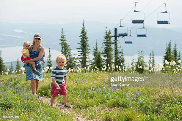 Family hiking on trail in summer