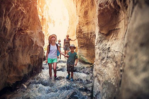 Family hiking through rivier in Andalusia, Spain 844084632