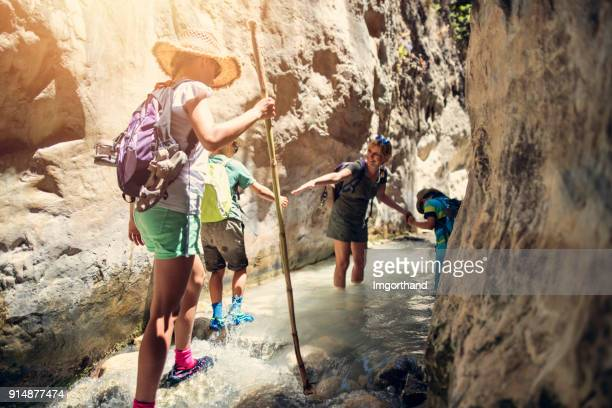 Family hiking through rivier in Andalusia, Spain
