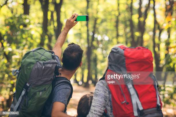 Family hiking together in forest