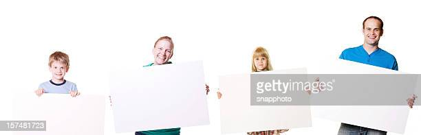 family holding blank cardboard poster signs - blank sign stock photos and pictures
