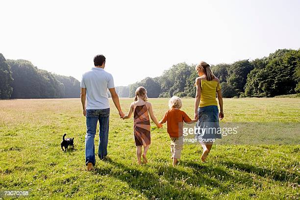 family holding hands - caucasian appearance stock pictures, royalty-free photos & images