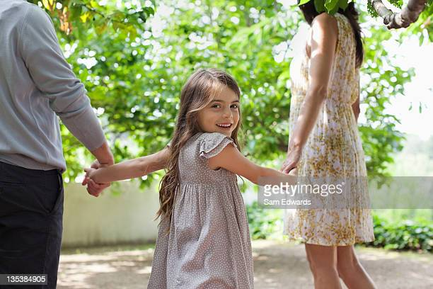 Family holding hands together outdoors