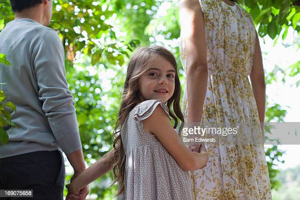 family holding hands together outdoors - mid section stock pictures, royalty-free photos & images