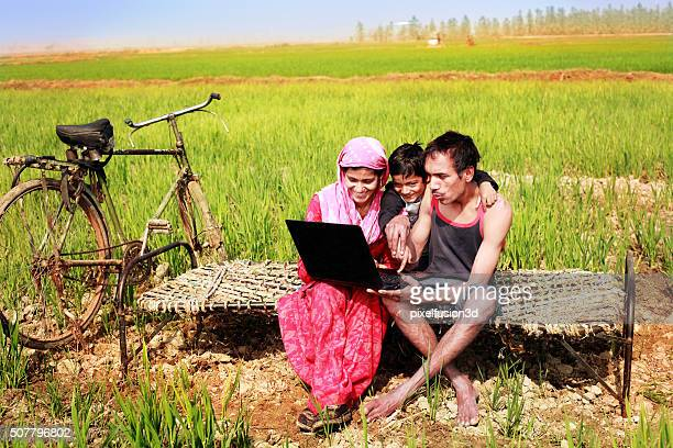Family Holding Laptop in the wheat field