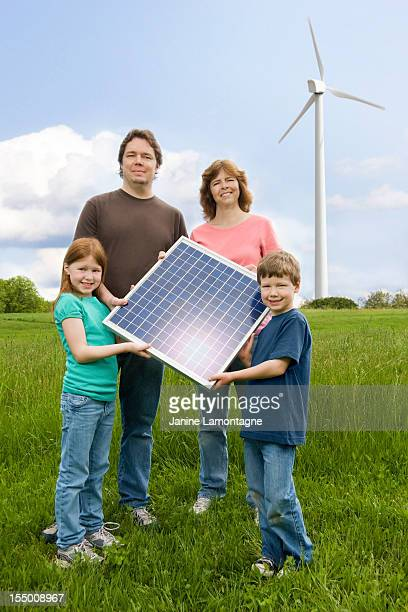 Family holding Solar Panel