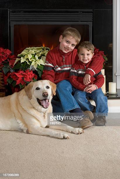 Family Holiday Christmas Card Portrait, Brothers, Dog, Fireplace, Fire & Poinsettias.
