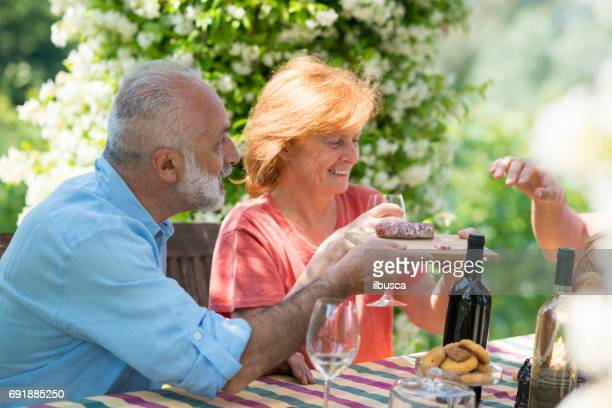 family holidays in langhe region, piedmont, italy: drinking wine and eating food outdoor - piedmont italy stock pictures, royalty-free photos & images