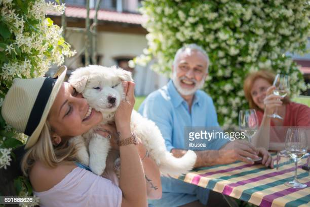 family holidays in langhe region, piedmont, italy: drinking wine and eating food outdoor - dog eats out girl stock photos and pictures