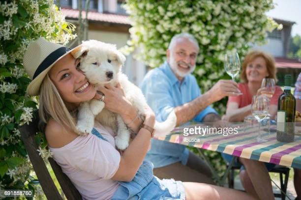 family holidays in langhe region, piedmont, italy: drinking wine and eating food outdoor - dog eating a girl out stock photos and pictures
