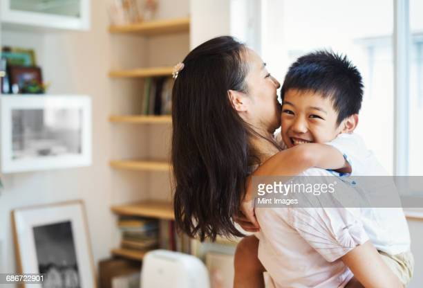 Family home. A mother and her son cuddling.