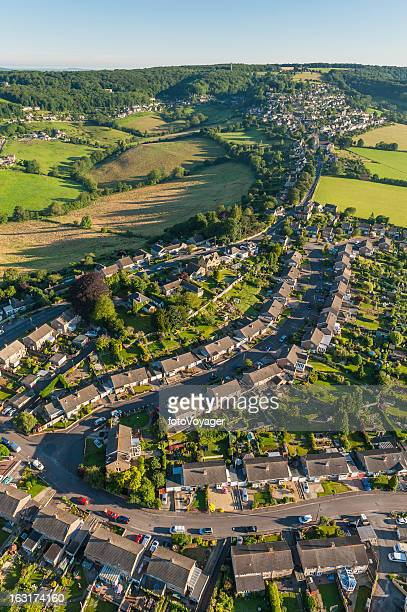 family homes suburban housing idyllic summer streets aerial photograph - overhemd en stropdas stock pictures, royalty-free photos & images