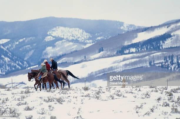 Family Horseback Riding in the Snow