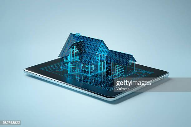 family house sitting on tablet pc - internet delle cose foto e immagini stock