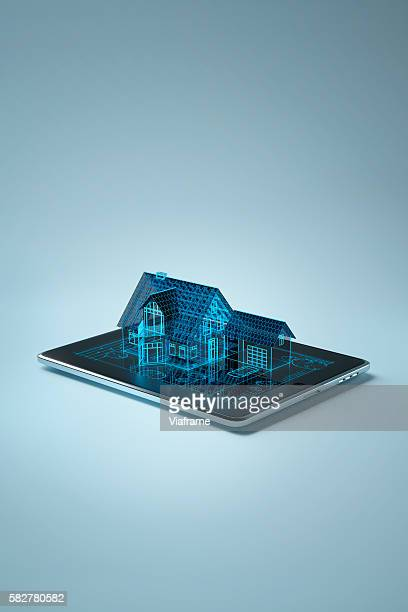 Family house sitting on tablet pc