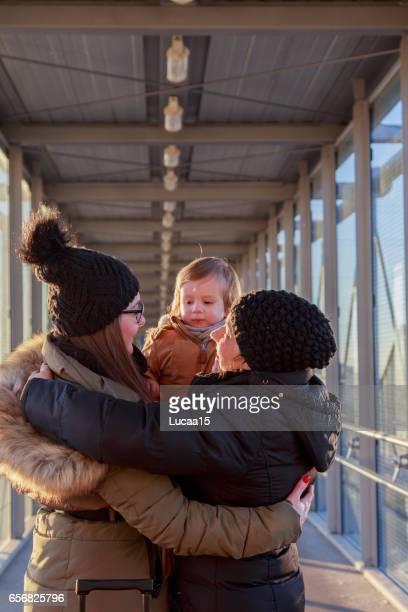 family hug - farewell - europäischer abstammung stock pictures, royalty-free photos & images