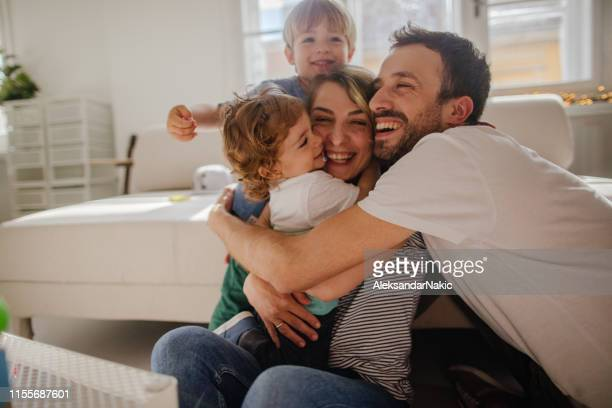 family hug - family at home stock photos and pictures