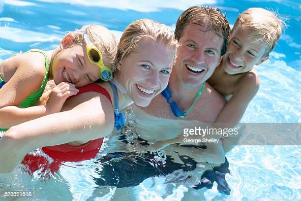 Family Hugging in Swimming Pool