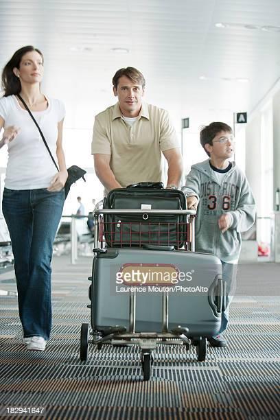Family hurring through airport