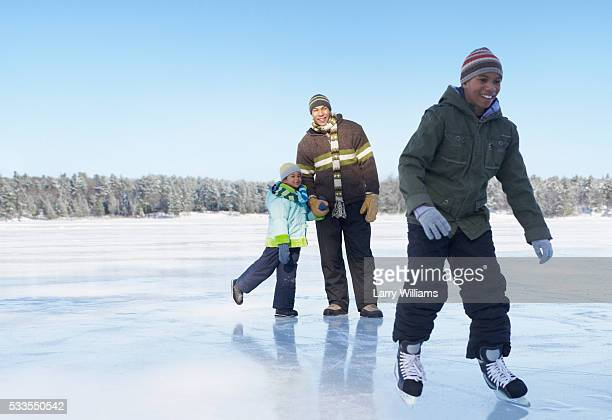family ice skating on frozen lake - ice skate stock pictures, royalty-free photos & images