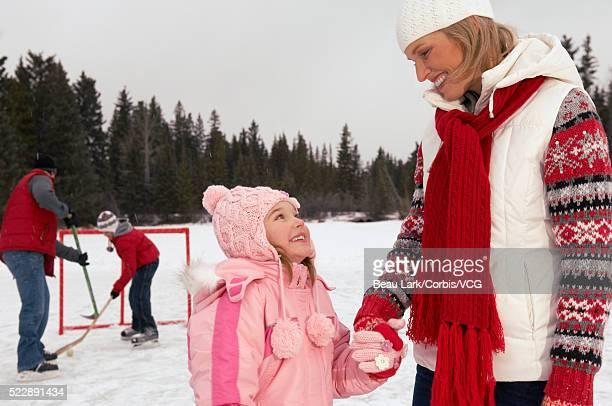family ice skating outdoors - アイスホッケーグローブ ストックフォトと画像