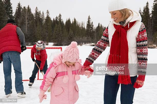 family ice skating together - アイスホッケーグローブ ストックフォトと画像