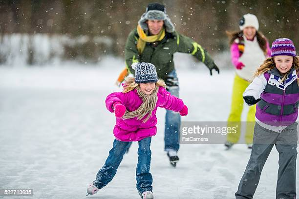 Family Ice-Skating on Pond