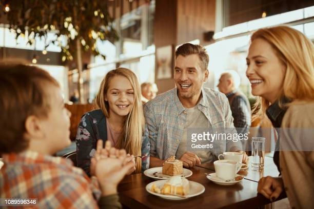 family in a cafe - restaurant stock pictures, royalty-free photos & images