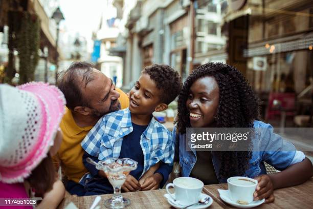 family in a cafe - stepfamily stock photos and pictures