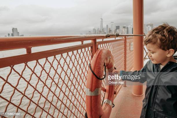 family in a ferry in new york city - staten island stock pictures, royalty-free photos & images