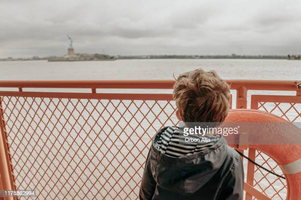 family in a ferry in new york city - staten island ferry stock pictures, royalty-free photos & images