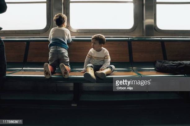 family in a ferry in new york city - ferry stock pictures, royalty-free photos & images