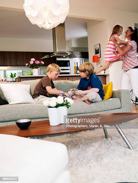 Family in a living room, Sweden.