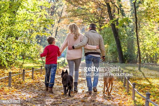 Hispanic Family Walking Dog Stock Photo