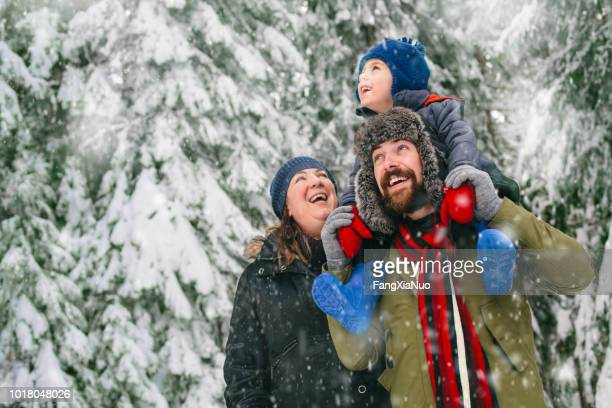 family in a winter walk - winter stock pictures, royalty-free photos & images