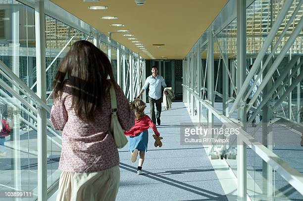family in airport arrivals walkway - elevated walkway stock pictures, royalty-free photos & images