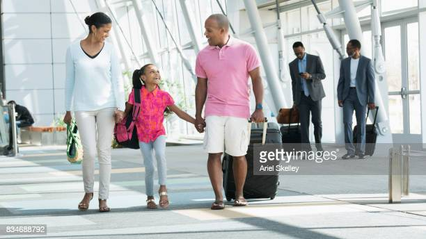 family in airport going on vacation - 公共の建物 ストックフォトと画像