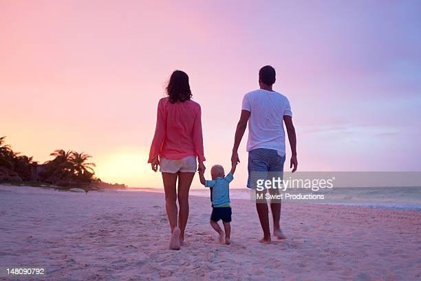 family in beach vacation walk - baby m ストックフォトと画像