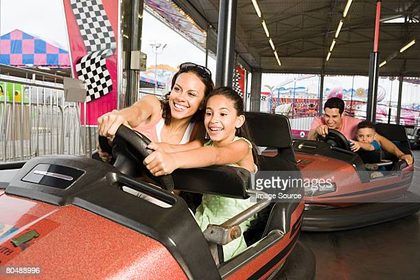 family in bumper cars - amusement park stock pictures, royalty-free photos & images