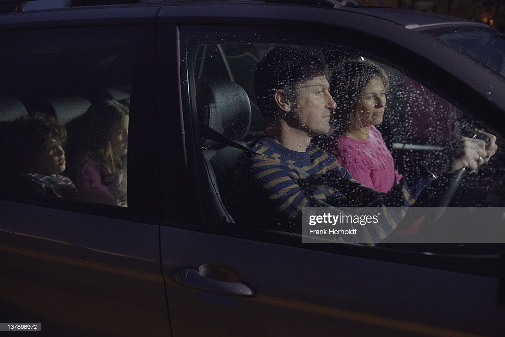 Family in car at night : Stock Photo