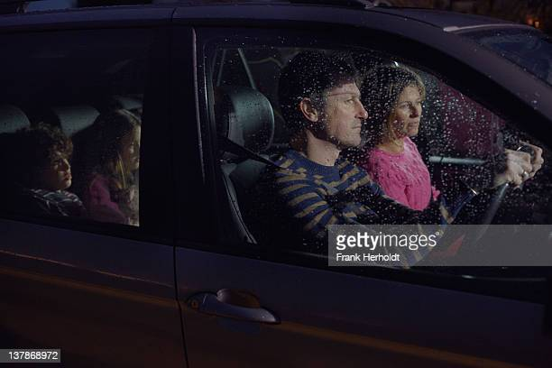 family in car at night - mother son shower stock photos and pictures