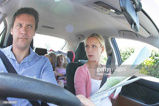 family in car, children asleep, parents with map - irritation stock pictures, royalty-free photos & images