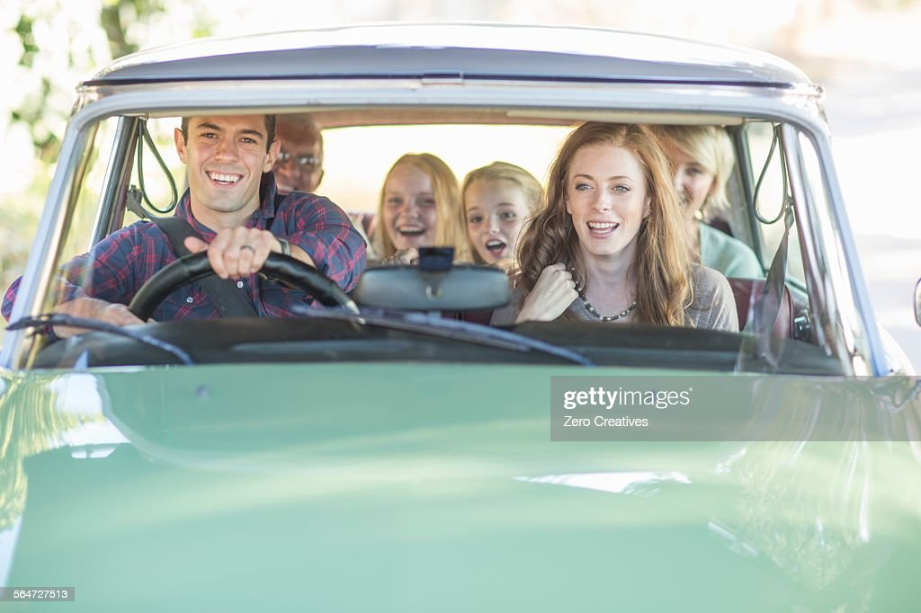 Family in car together, taking road trip : Stock Photo