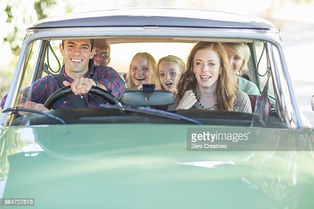 family in car together, taking road trip - family inside car stock photos and pictures