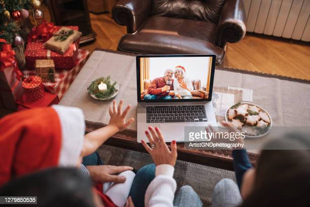 family in christmas video call. - public celebratory event stock pictures, royalty-free photos & images